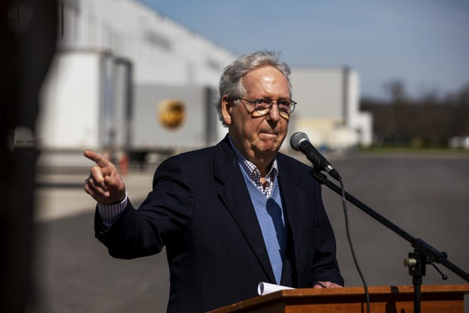 Senate Minority Leader Mitch McConnell gestures while speaking to the media after he toured the McKesson distribution center in Shepherdsville, Ky. Tuesday, March 30, 2021