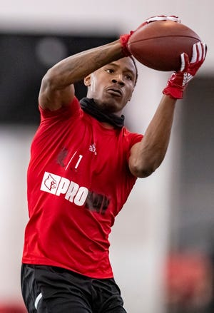 Tutu Atwell catches a pass during the University of Louisville's Football Pro Day at the Trager indoor practice facility on Tuesday. March 30, 2021. Atwell could be an intriguing option for the Cleveland Browns in the upcoming NFL Draft. [Alton Strupp/Courier Journal]