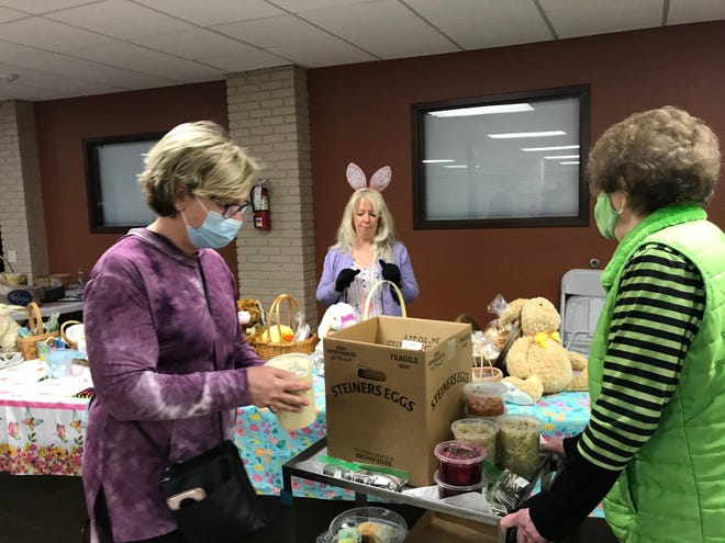 The St. Peter's Easter Bake Sale was a huge success Tuesday in the church basement downtown. At left DiAnn Kuhn, and her mother Dinean Tacik, buy cabbage with noodles, broccoli soup, beets with eggs, cabbage rolls and some chocolate treats to serve during Holy Week.