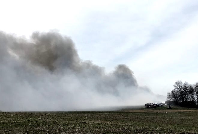 A state wildlife officer at the scene of Tuesday's fire at Keegan Enterprises on Ohio 101 said pallets, rubber and propane were involved in the blaze.