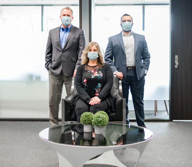 Photographed in Alluvial's office suite at 107 N. Main, Marion, are (L to R): Lars Olson, CFP®, CPFA; Lisa Bush (seated); and Manoj Sharma.  All three are wealth advisors with Alluvial Private Wealth.