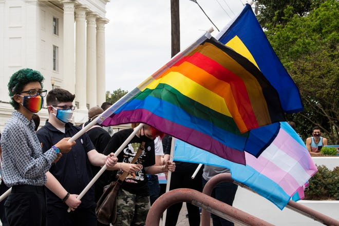File photo of protestors in support of transgender rights rally outside the Alabama State House in Montgomery, Ala., on Tuesday, March 30, 2021.