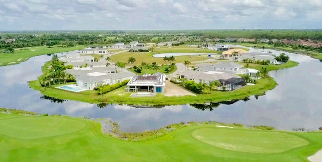 Every home in Peninsula Treviso Bay overlooks a lake and the finishing holes of the community's TPC golf course.