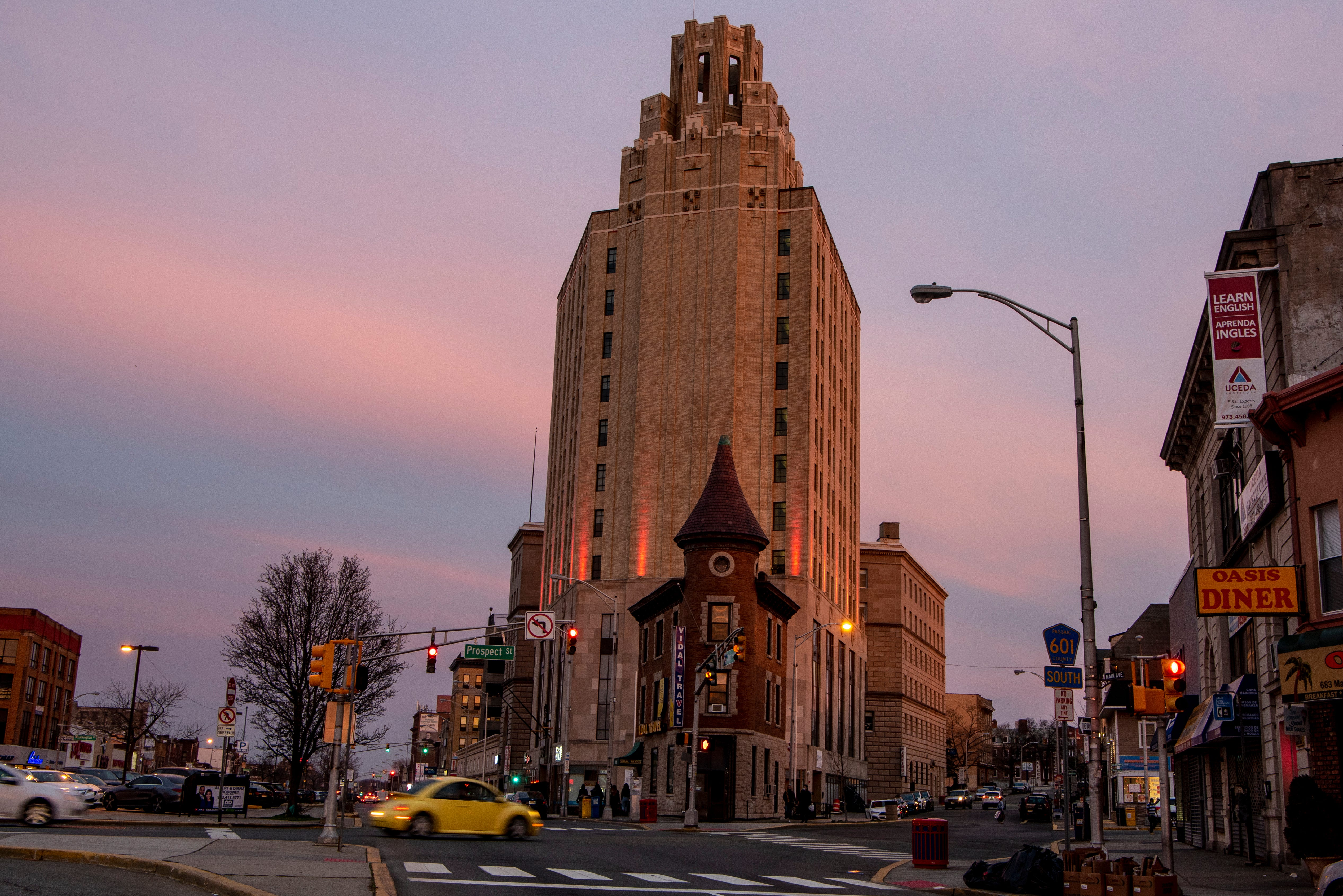 As the sun sets, the clouds turn the color of cotton candy behind the 11-story Art Deco building that sits at 663 Main Ave. The building was originally a bank when it opened in 1931, but now houses a Blink gym.