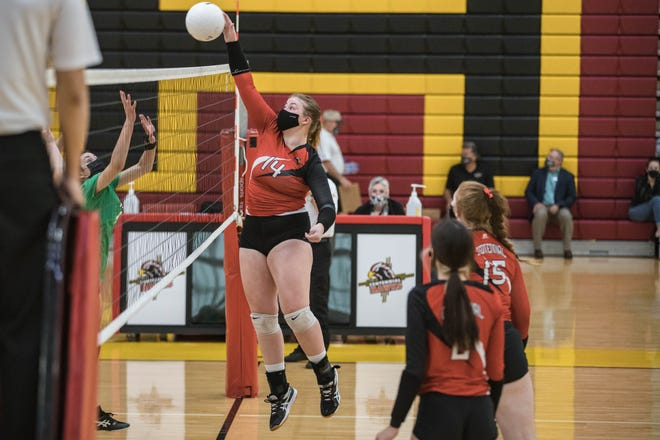 Cora Dubois (14) spikes the ball as the Centennial Hawks play the Albuquerque Bulldogs at Centennial High School in the Quarterfinals of the New Mexico 5A Volleyball championships in Las Cruces on Tuesday, March 30, 2021.
