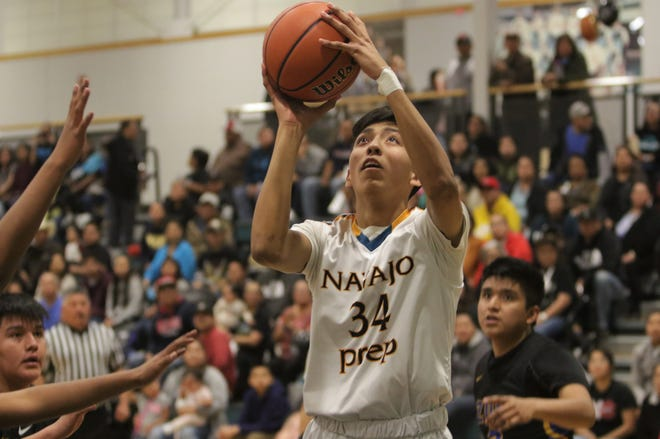Navajo Prep's Javy Atcitty goes in for a layup against Zuni on Wednesday, Feb. 19, 2020, at the Eagles Nest in Farmington. Prep's board of trustees approved a hybrid learning plan to allow Prep's boys and girls basketball seasons to begin.