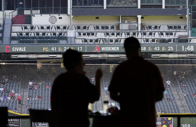 Mar 30, 2021; Phoenix, Arizona, USA; TGI Fridays Front Row restaurant is closed and signage removed above the left field stands during a spring training game at Chase Field. Mandatory Credit: Rob Schumacher-Arizona Republic