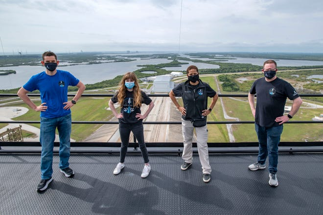 In this photo provided by SpaceX, Jared Isaacman (from left), Hayley Arceneaux, Sian Proctor and Chris Sembroski pose for a photo on March 29, 2021, from the SpaceX launch tower at NASA's Kennedy Space Center at Cape Canaveral, Florida.