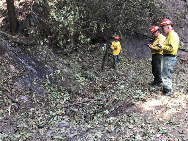National Park Service investigators collect data from the 2018 Carr Fire. The park service released the findings of the 2018 Carr Fire investigation in a approximately 2,500-page report on Tuesday, March 30, 2021.