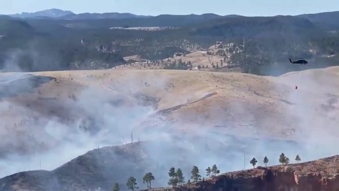 Fire departments across western South Dakota continued to fight the Schroeder Fire west of Rapid City on Tuesday.