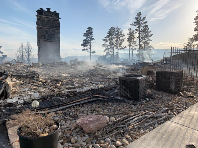 Officials say two homes were destroyed in the Schroeder Fire west of Rapid City on Monday.