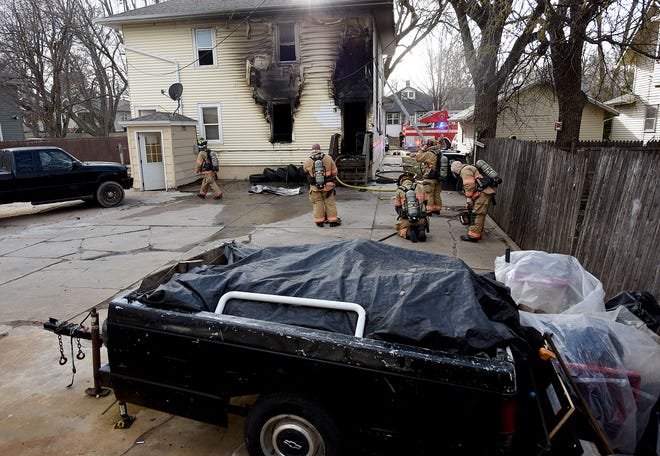 Sioux Falls Fire Rescue works on a house fire at 806 S. Summit Ave. Monday afternoon.