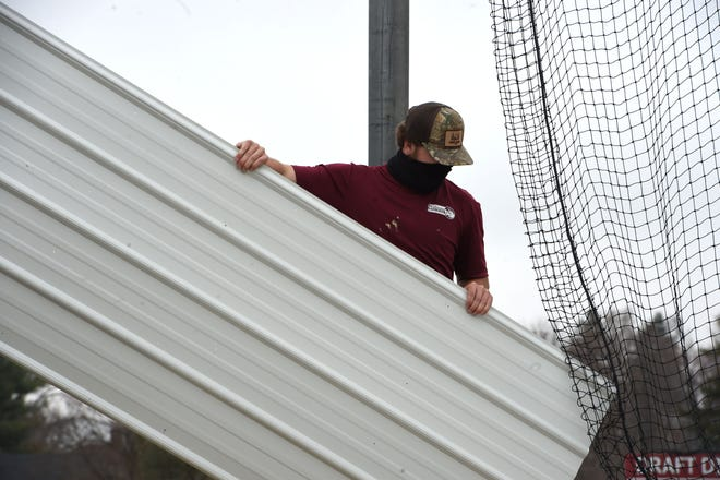 Trenton Gruver, a Wilson Memorial senior, helps during a Valley Career and Technical Center project at the Diamond Club in Stuarts Draft.