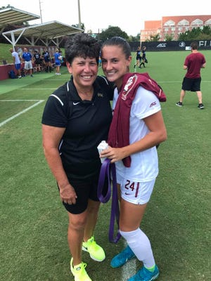 Robin Gibson with FSU player Maddie Pezzino after Pezzino scored two goals against Kentucky in 2017.