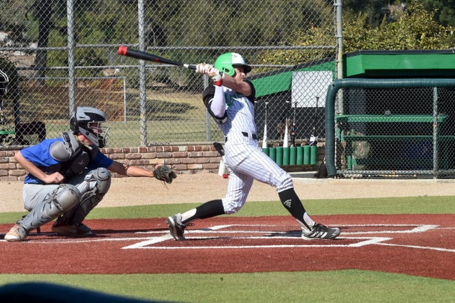 Thousand Oaks High's Roc Riggio takes a big swing against Westlake during a game on Monday, March 29, 2021. Riggio had his home run streak halted Monday, but the unbeaten Lancers still powered their way to a 14-9 win.