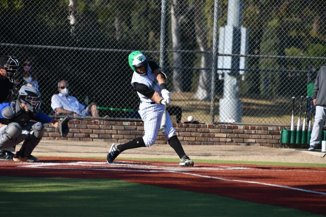 Thousand Oaks High's Charlie Saum connects for a three-run homer against Westlake in a Marmonte League game on Monday, March 29, 2021. Saum had two homers in the Lancers' 14-9 win.