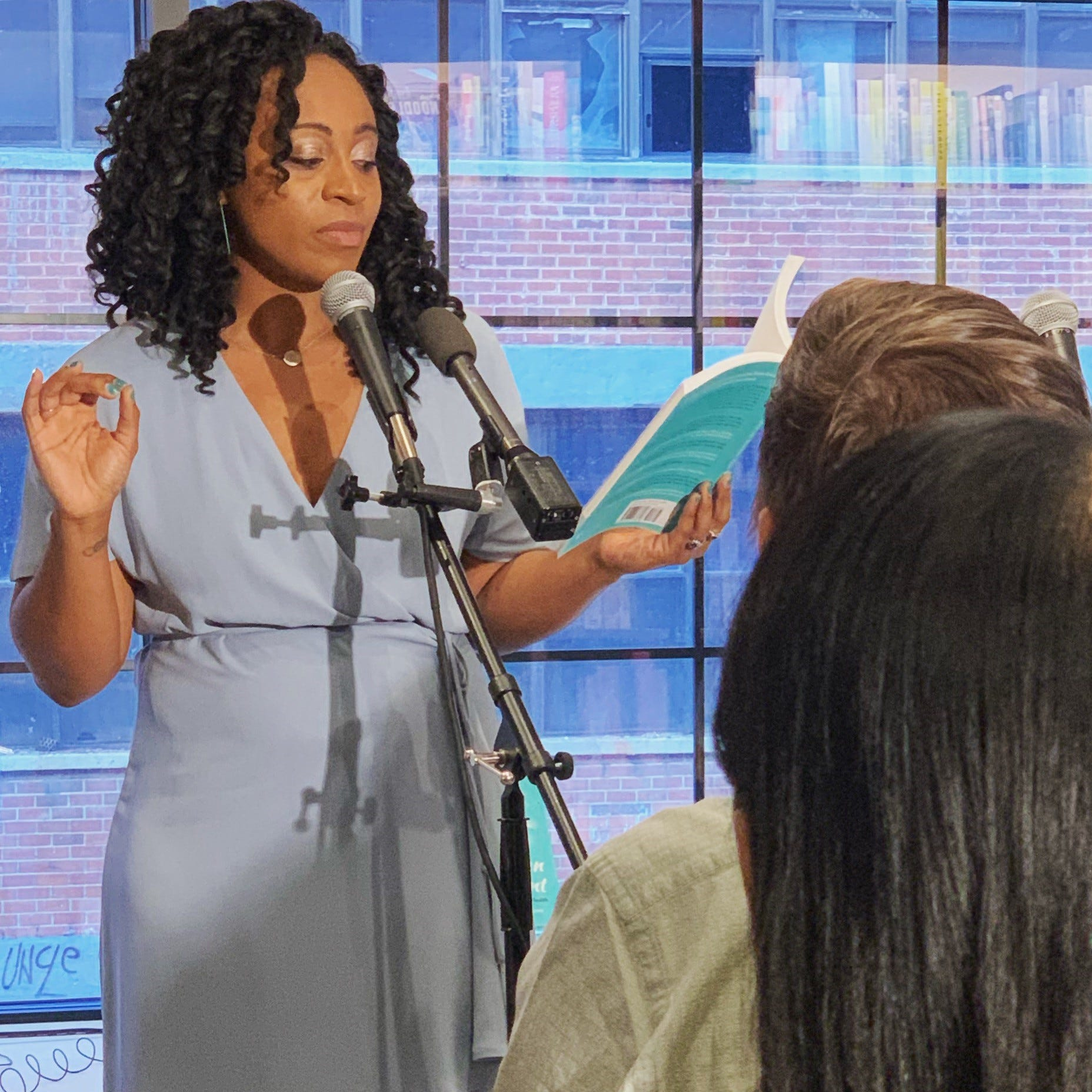"""Kelechi Ubozoh reads from her book """"We've Been Too Patient: Voices From Radical Mental Health"""" at a 2019 event at McNally Jackson Independent Booksellers in Brooklyn."""