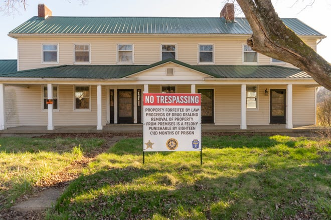 A house a 5230 Chandlersville Road sold at auction Saturday as part of the $1 million raised for future law enforcement endeavors in Zanesville and Muskingum County.