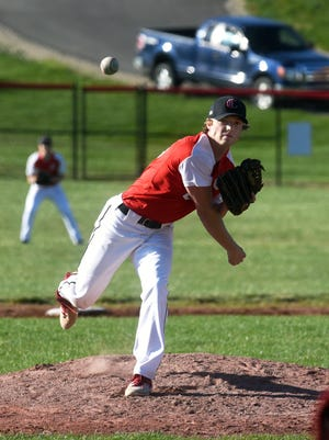 Caden Sparks fires a pitch during the third inning of Crooksville's 5-1 win against visiting Coshocton on Monday in McLuney. Sparks pitched a complete game with eight strikeouts.