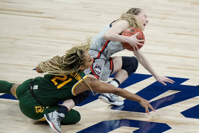 Paige Bueckers and DiJonai Carrington go after a loose ball during the second half of their Elite Eight game in San Antonio.