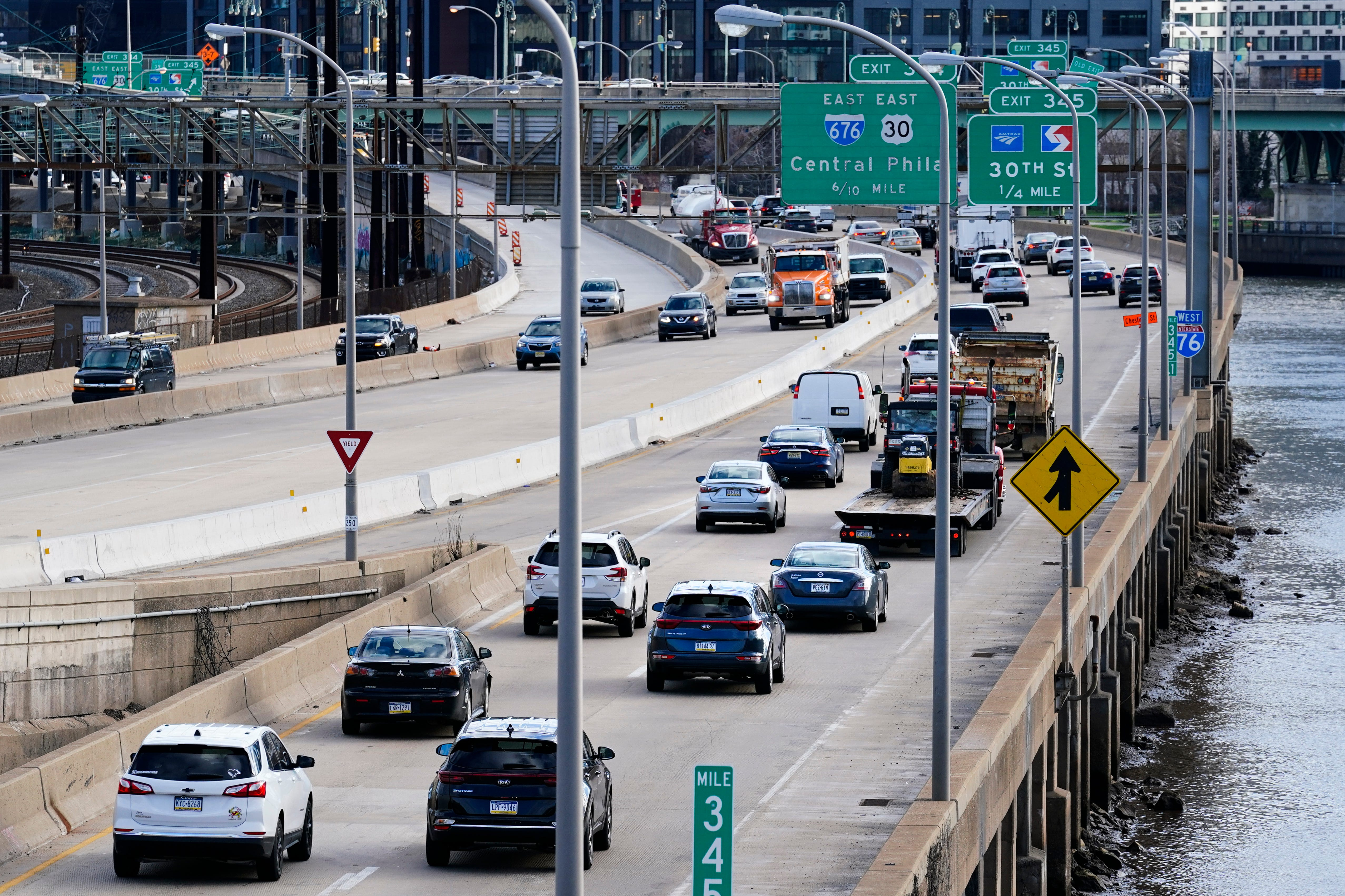 Morning traffic moves along Interstate 76 in Philadelphia on March 29, 2021.