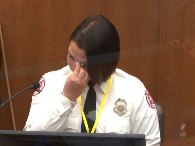 In this image from video, Minneapolis Firrefighter Genevieve Hansen, wipes her eyes as she testifies as Hennepin County Judge PeterCahill presides Tuesday, March 30, 2021, in the trial of former Minneapolis police Officer Derek Chauvin, in the May 25, 2020, death of George Floyd at the Hennepin County Courthouse in Minneapolis, Minn.