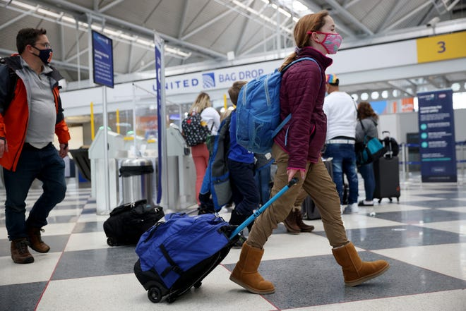 The Transportation Security Administration screened more than 2 million people on Friday, a major milestone for the travel industry's return.