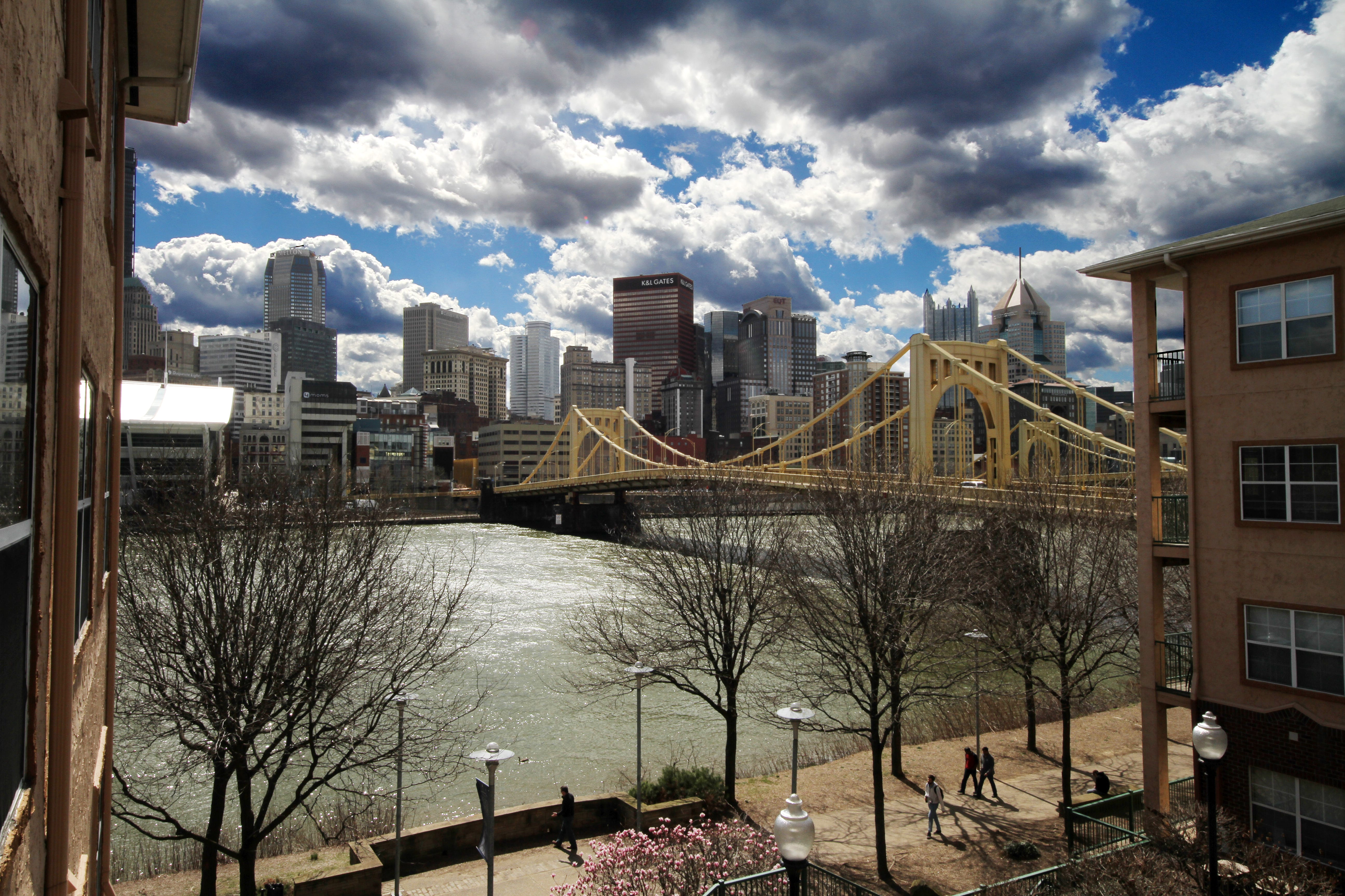 Clouds hang over the skyline of downtown Pittsburgh, the Rachel Carson Bridge, and the Allegheny River on Friday, March 18, 2016.