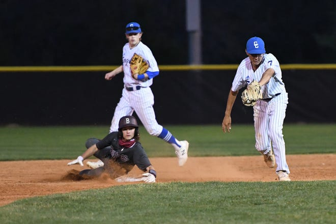 Cedar Creek's Gabriel Gonzalez, right, tries to make a tag at second base during the Eagles' 3-1 loss to Bastrop Tuesday.