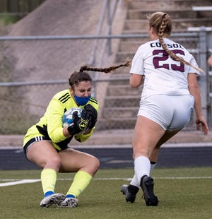 McCallum keeper Lindsey Plotkin scoops up the ball just in front of A&M Consolidated's Lily Hickson during a girls high school soccer playoff game at Nelson Field on Tuesday. Plotkin had five saves in A&M Consolidated's 5-0 win.