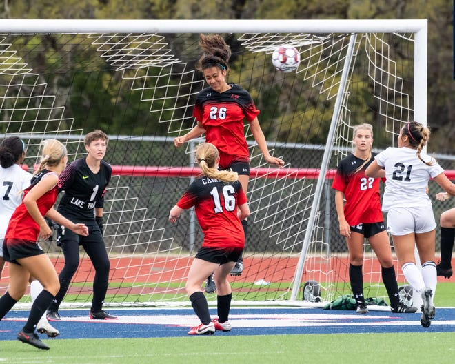 Sofia Guerrero of Lake Travis heads the ball away from the Cavs' goa as Lake Travis won a girls area round soccer playoff match over Steele 2-0 at Wimberley on Tuesday.