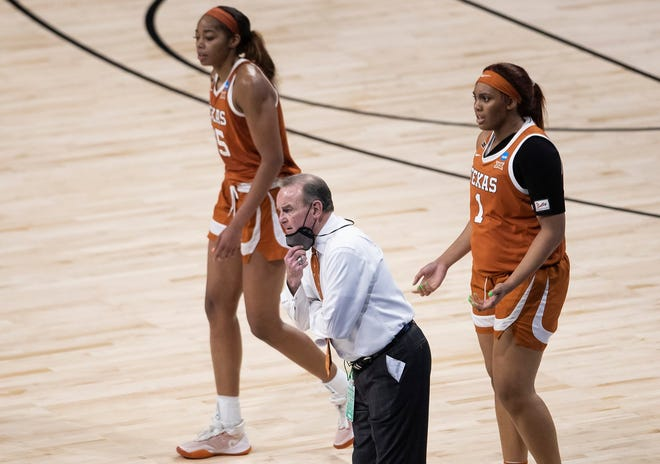 Texas coach Vic Schaefer calls out to his team as Charli Collier and Lauren Ebo look on against South Carolina during Texas' regional final loss on Tuesday. Schaefer vows to have the Longhorns making deep tournament runs for years to come.