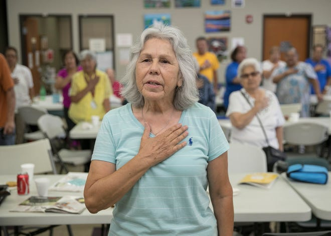 Volunteer Elsa Solis, a retired state social worker, leads the pledge of allegiance at the Willie M. Cortez Senior Center in San Antonio in 2019. Solis said she delayed repairs to her cars and home because she couldn't afford them. She wanted to see state lawmakers boost the state pension system. [JAY JANNER/AMERICAN-STATESMAN/FILE]
