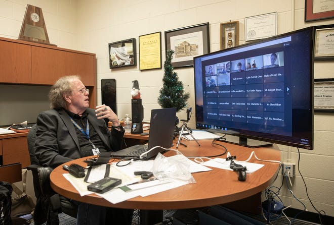 Anderson High School orchestra director Richard Frazier teaches an online orchestra class last month. Frazier, who is retiring, is concerned that a new staffing plan could prompt teachers to leave the district.