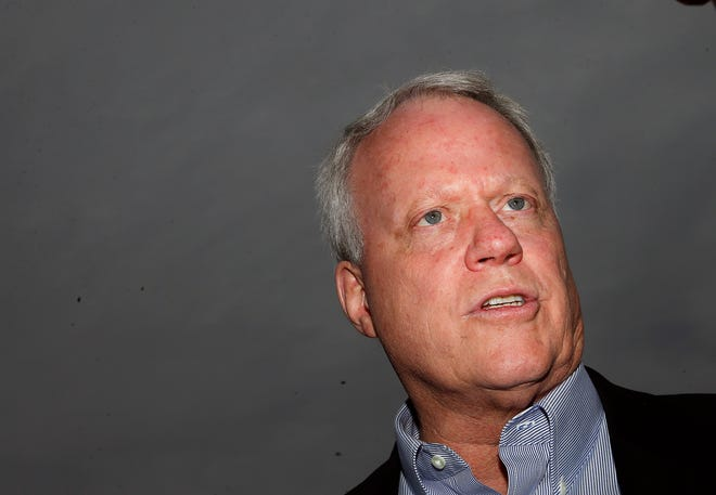 """In this May 17, 2014 file photo Rep. Paul Broun, R-Ga, and candidate for US Senate talks to voters during the """"Grillin with the Governor"""" campaign event in Buford, Ga."""