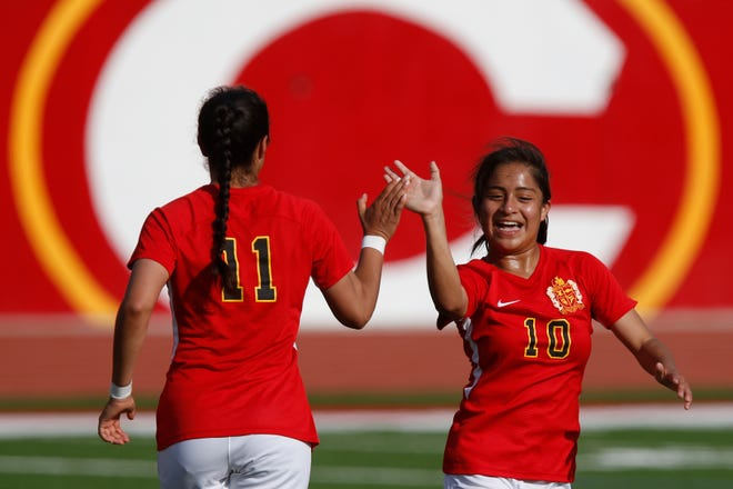 Clarke Central's Mayra Sesmas (11) and Joselin Ulloa (10) celebrate a goal during a March game. Sesmas, a junior forward who had 17 goals and seven assists, made the Athens Banner-Herald's All-Area team.[Joshua L. Jones/Athens Banner-Herald]
