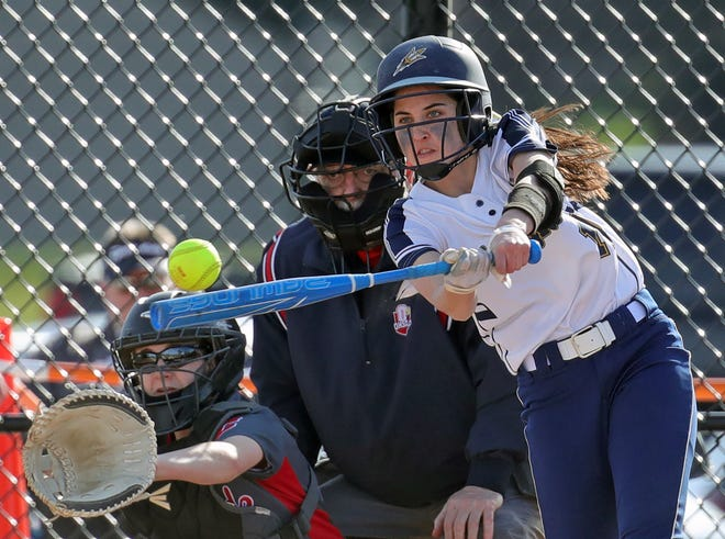 Tallmadge batter Marley Queen connects with a pitch during the first inning of a softball game against Crestwood, Tuesday, March 30, 2021, in Tallmadge, Ohio. [Jeff Lange/Beacon Journal]