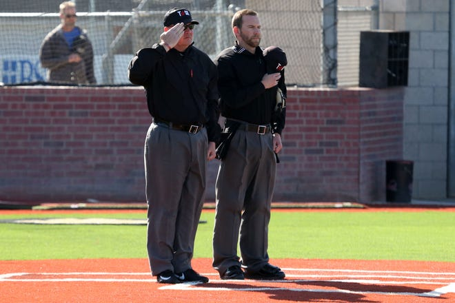 Game officials stand during the National Anthem before a District 3-5A game between Amarillo High and Plainview at Sandie Field. [Michael C. Johnson/For Amarillo Globe-News]