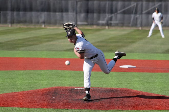 Mar 30, 2021; Amarillo, Texas, USA;  Amarillo High School Sandies pitcher Tristan Curless (30) delivers a pitch against the Plainview Bulldogs at Sandie Field.  Michael C. Johnson/for Amarillo Globe-News