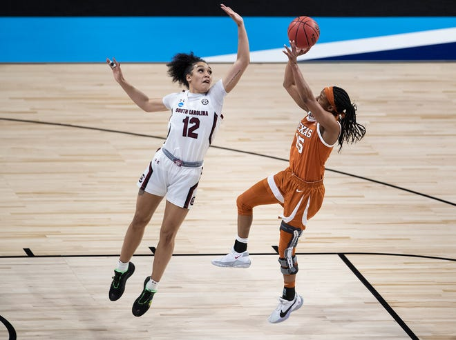 South Carolina guard Brea Beal blocks Texas guard Kyra Lambert's shot during the first half of Tuesday night's 62-34 Gamecocks victory in the Elite Eight of the NCAA Tournament. Lambert, a graduate transfer from Duke, played her final college game.
