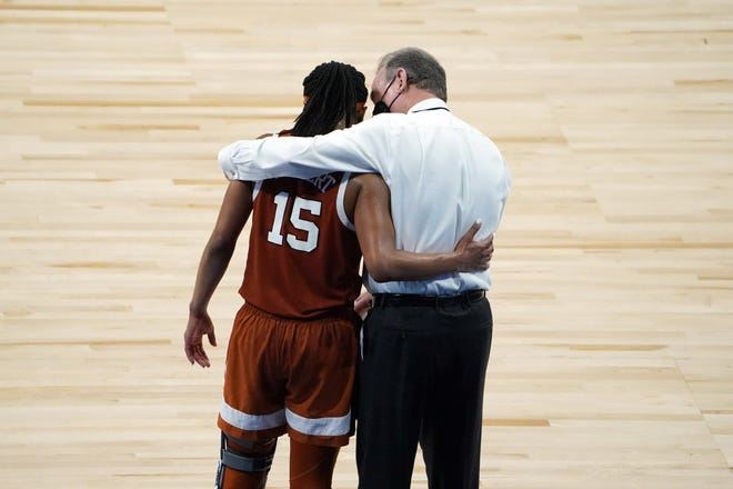 """Texas head coach Vic Schaefer comforts senior point guard Kyra Lambert in her final game as a Longhorn after Tuesday night's loss to South Carolina in the Elite Eight. """"It's a new program, new culture, new everything, new players,"""" said Lambert, who joined UT as a graduate transfer from Duke. """"We're exactly where we wanted to be."""""""