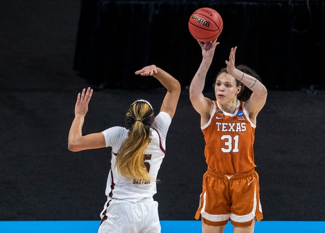 Texas guard Audrey Warren (31) shoots and scores over South Carolina's Victaria Saxton (5) on March 30, 2021 at the Alamodome in San Antonio.