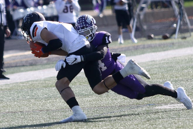 Mount Union's Malik Britt, right, brings down Ohio Northern's Chase Ross during their OAC conference game at Mount Union Stadium on Saturday, November 2, 2019.