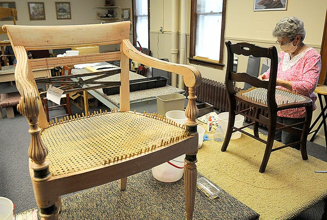 Linda Ramsey works on caning chairs at the Senior Citizen Center Wednesday, March 31, 2021. TOM E. PUSKAR/TIMES-GAZETTE.COM