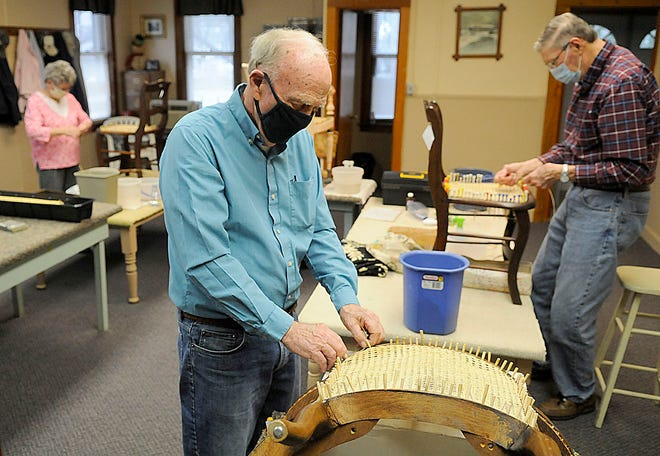 Tom Herron, Linda Ramsey and Paul Goard work on caning chairs at the Ashland Senior Citizen Center Wednesday, March 31, 2021. Chair caning is one of the ways the Senior Citizen Center raises money.