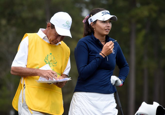 Alexa Pano stands with her caddie before teeing off on the first hole to open the 2021 Augusta National Women's Amateur at Champions Retreat Golf Club in Evans.