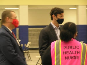 U.S. Sen. Jon Ossoff, D-Ga., tours the East Central Health District's COVID-19 vaccination site on Wednesday with Dr. Stephen Goggans (left), the health district director.
