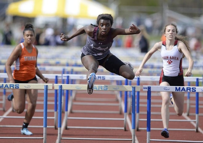 Ambridge's Bethany Naughton clears a hurdle in the 100 hurdles at the 2019 MAC championships. Naughton is the defending champ in the event and one of Ambridge's top returning competitors.