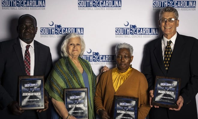 Jeremiah Faber, left, was inducted into the S.C. Basketball Coaches Hall of Fame on March 26 along with Betty Moore, Arsonia Stroud and Mark Freeze.
