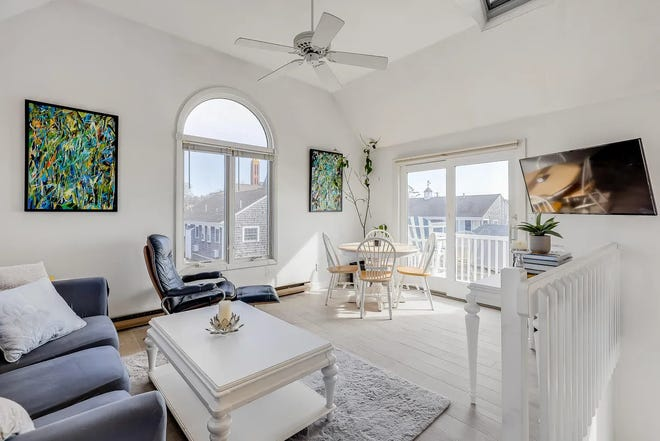 The living room looks out over the neighborhood.  [STEVE STROJNY/SOTHEBY'S INTERNATIONAL REALTY]